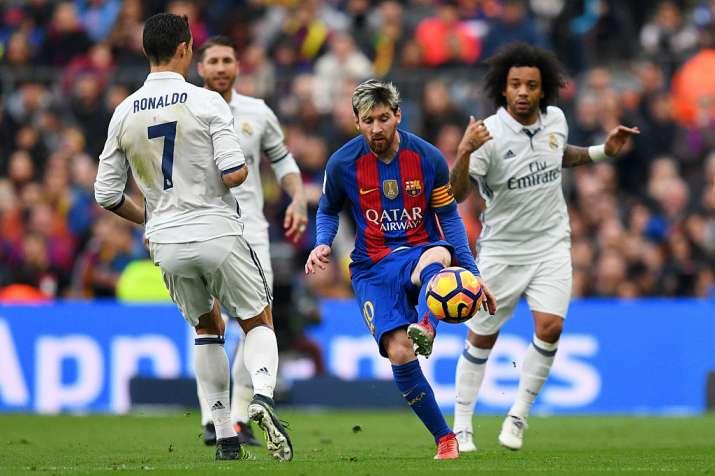 Messi dribbles past Ronaldo in the El Clasico.