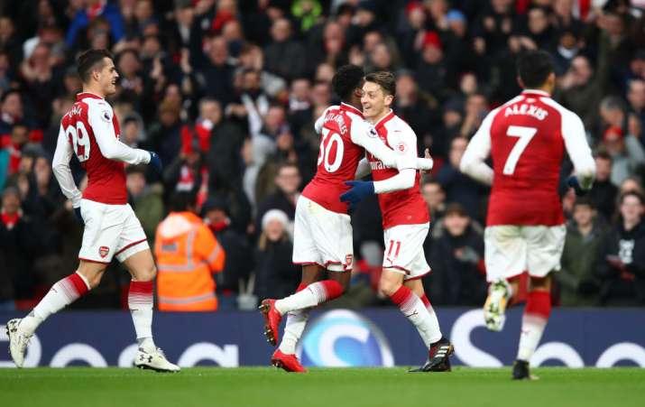 India Tv - Arsenal players celebrate after scoring.
