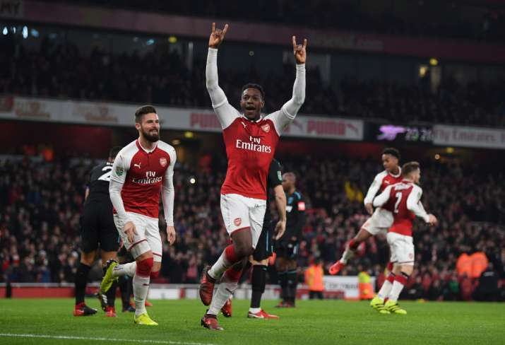 India Tv - Arsenal players celebrate after scoring.