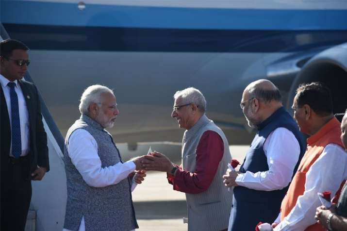 India Tv - PM Modi welcomed by Gujarat Governor OP Kohli to the state.