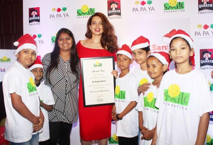 India Tv - Kangana Ranaut with underprivileged kids