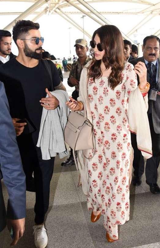 India Tv - Virat Kohli and Anushka Sharma at Delhi airport