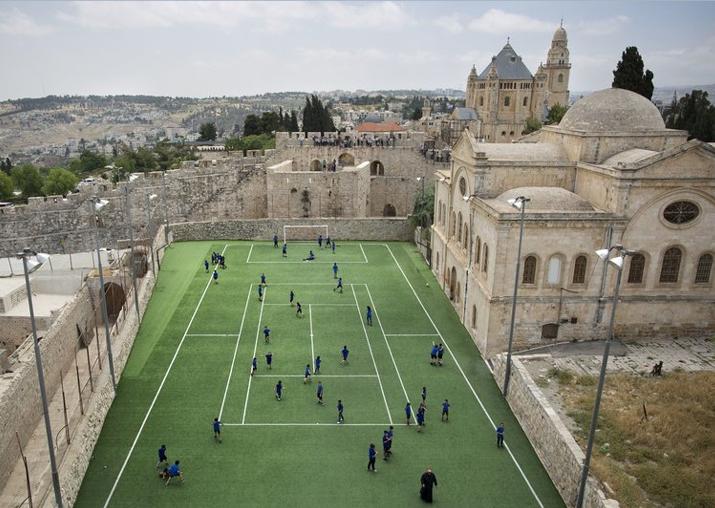 Armenian school kids play in the soccer field located next
