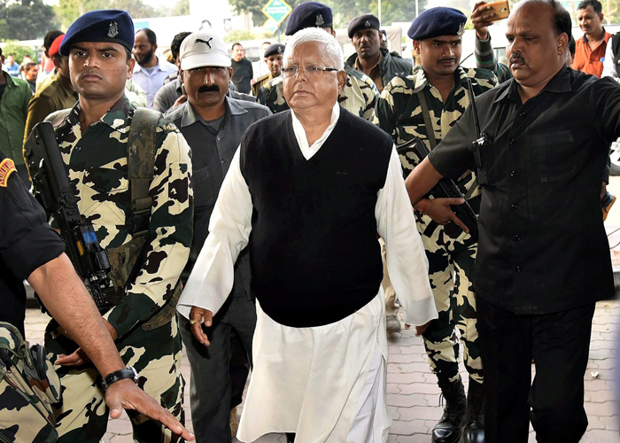India Tv - RJD chief Lalu Yadav seen at Patna airport as he leaves for Ranchi where a special CBI judge is expected to pronounce judgment in fodder scam case.