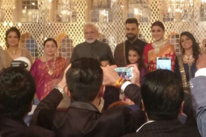 PM Modi attends Virat-Anushka wedding reception, showers