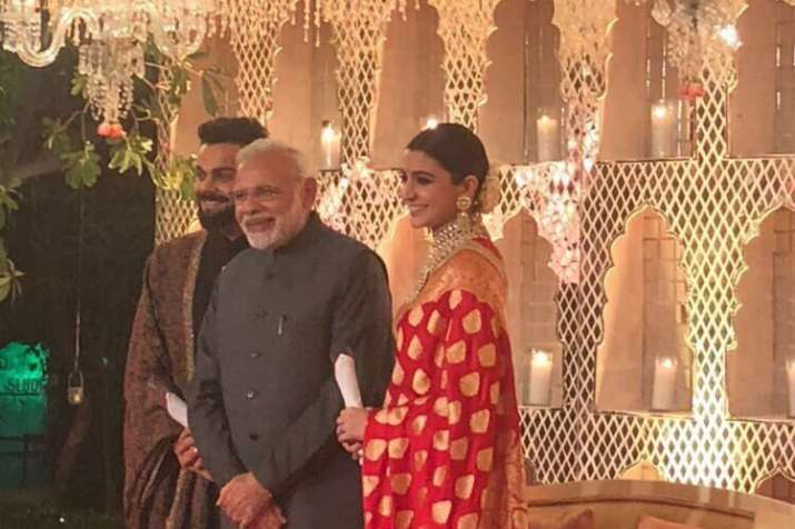 India Tv - PM Modi with Virat Kohli and Anushka Sharma at the reception event