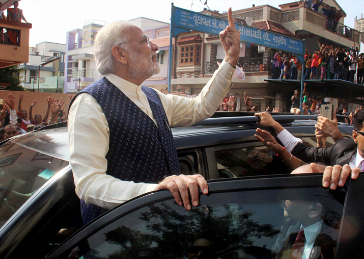 India Tv - PM Modi shows his finger marked with indelible ink, as he leaves after casting his vote at Ranip in Ahmedabad