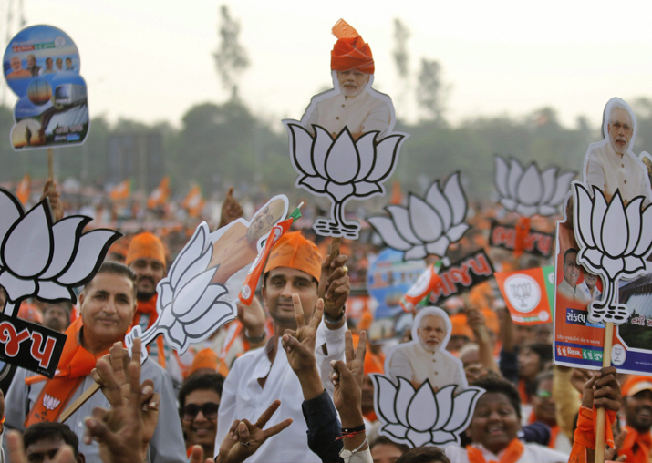India Tv - Supporters of BJP duirng PM Narendra Modi's election campaign rally, in Nadiad in Kheda district on Monday