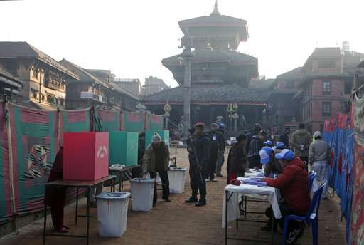 Nepalese people cast their vote during the legislative