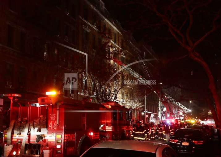 Firefighters respond to a building fire in the Bronx