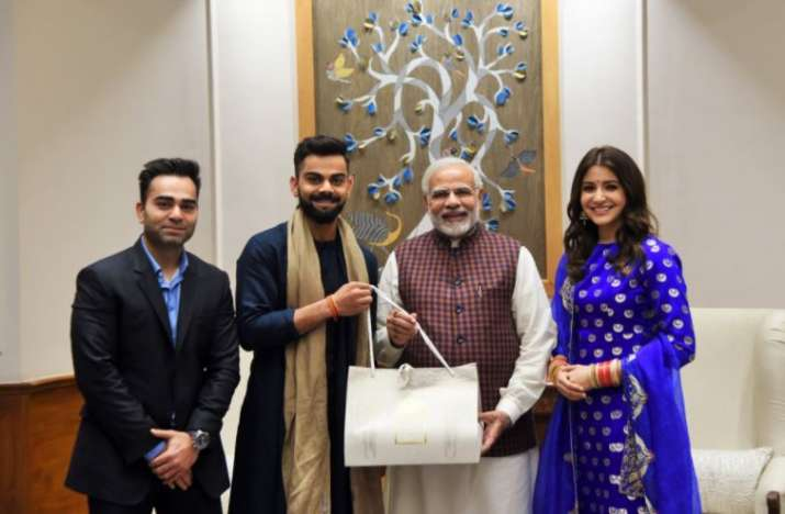 India Tv - Virat Kohli, Anushka Sharma greet PM Modi.
