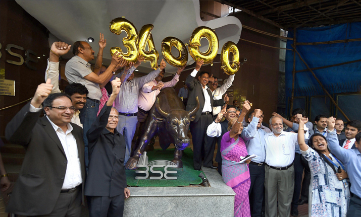 Brokers and BSE management celebrate as the Sensex crossed