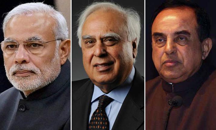 Left to right - PM Narendra Modi, Kapil Sibal and