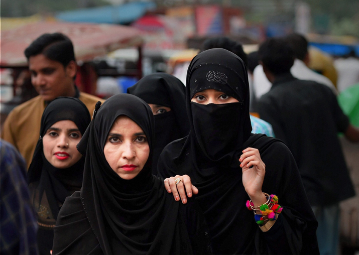 India Tv - File pic - Muslim women at a market in old Delhi on Tuesday