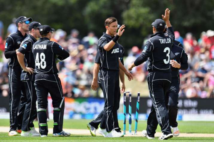 Trent Boult is congratulated by teammates after dismissing