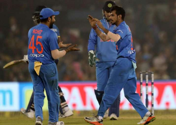 Yuzvendra Chahal celebrates with Rohit Sharma in Cuttack