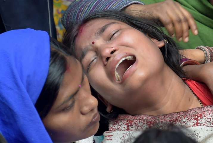 India Tv - Relatives of a Bawana fire victim mourns at her house in New Delhi on Sunday.