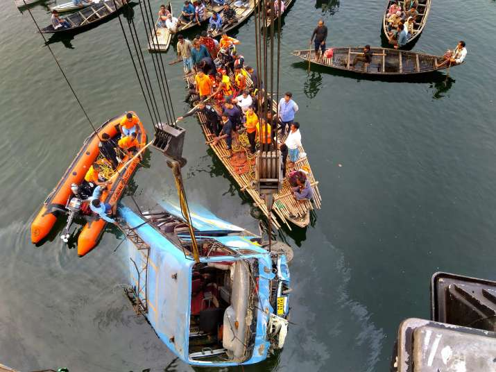India Tv - Murshidabad: Rescuers pulling out the ill-fated public bus which fell into the Bhairab river in Murshidabad district on Monday.