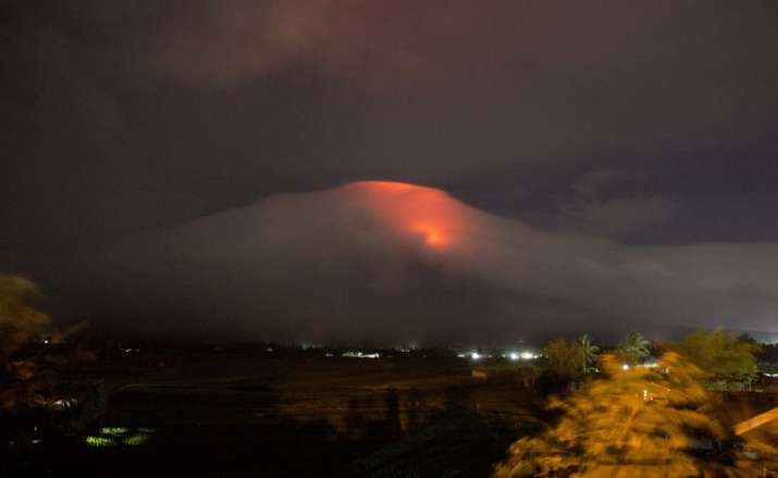 Orange glow seen at the cloud-shrouded crater of Mayon