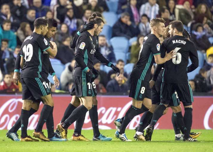 India Tv - Real Madrid players celebrate after scoring.