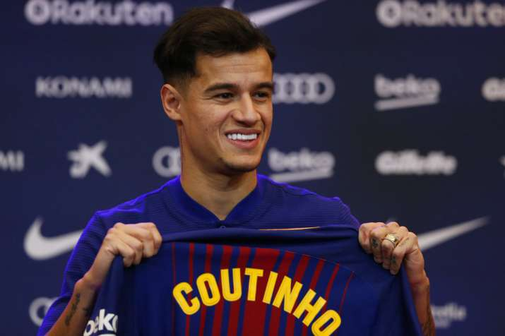 India Tv - Philippe Coutinho with the Barca shirt.