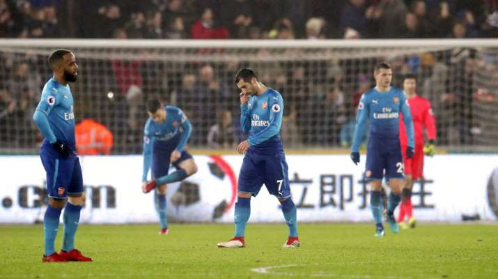 India Tv - Arsenal player look dejected after their loss to Swansea