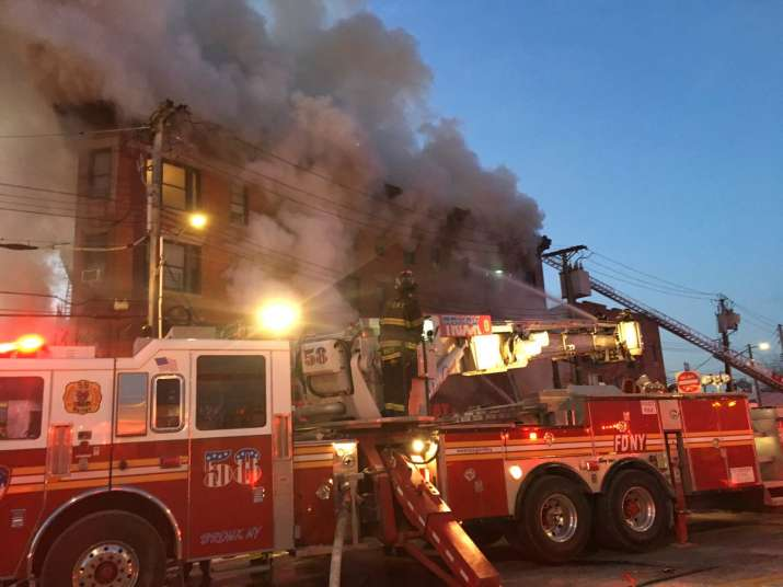 Blaze engulfs building in New York's Bronx, 12 hurt, 1