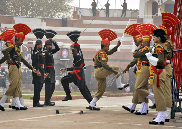 BSF and Pak Rangers lower their countries' flags during the
