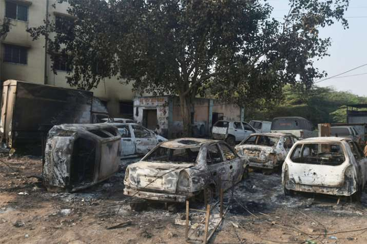 Charred vehicles following the violence during celebrations