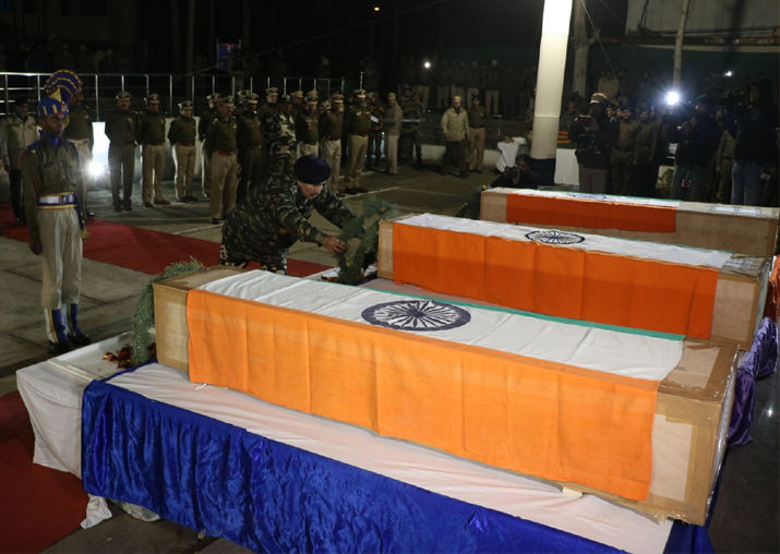 India Tv - Soldiers lay wreath at the mortal remains of the four CRPF troopers killed in Pulwama district after guerrillas attacked a CRPF training centre in Srinagar on Dec 31