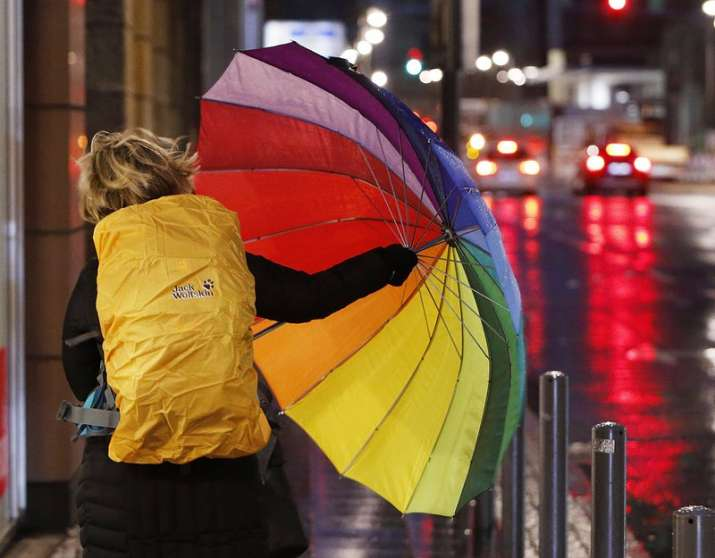 India Tv - A woman fights with her colorful umbrella as she walks in the city center of Frankfurt, Germany, on a stormy Thursday, Jan. 18, 2018. Heavy storms are forecasted for most parts of Germany on Thursday