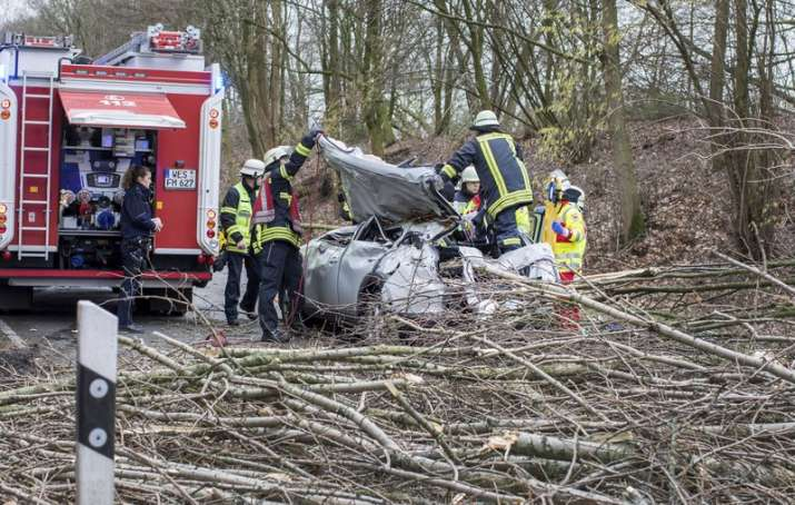 Rescue workers are busy at the site where a car was hit by