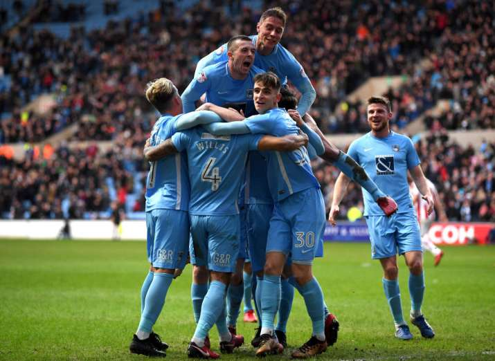 India Tv - Coventry players celebrate after scoring a goal.