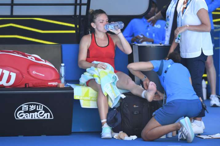 India Tv - Simona Halep is given treatment during the first round of the Australian Open