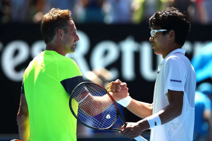 India Tv - Sandgren congratulates Chung after his win in the quarters.