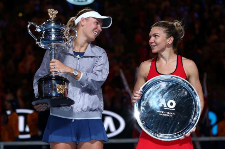 India Tv - Caroline Wozniacki and Simona Halep pose with their trophies.