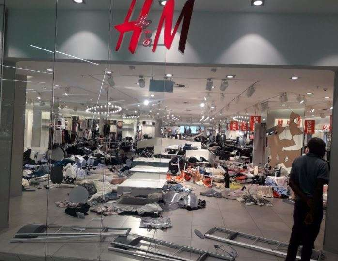 India Tv - The protestors broke into the HM stores and trashed the products.