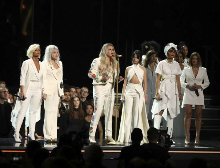 "India Tv - Kesha, performed ""Praying"" as Bebe Rexha, Cyndi Lauper, Camila Cabello, Andra Day and Julia Michaels look on at the 60th annual Grammy Awards."