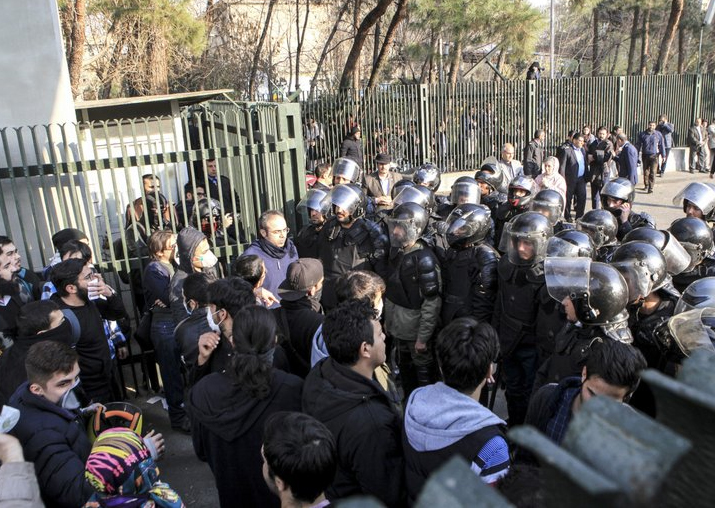 Anti-riot Iranian police prevent university students to
