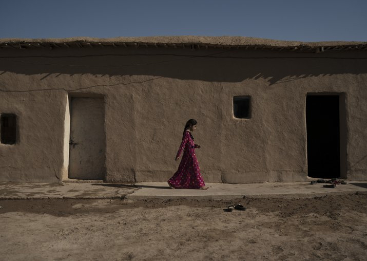India Tv - In this Nov. 12, 2017 photo, a girl walks outside her home in the Bijwaniya village, south of Mosul, Iraq