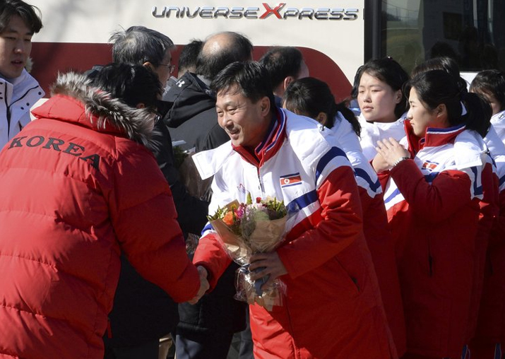 North Korean women's ice hockey players are greeted as