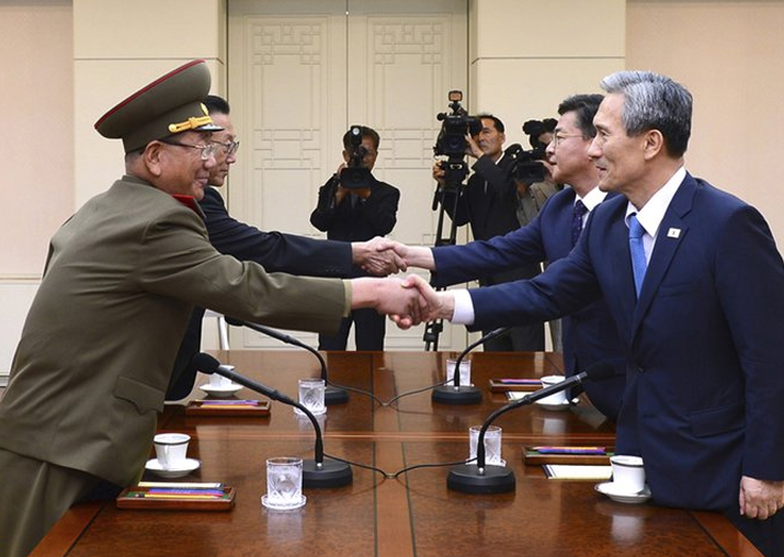 File pic - South Korean govt officials shake hands with