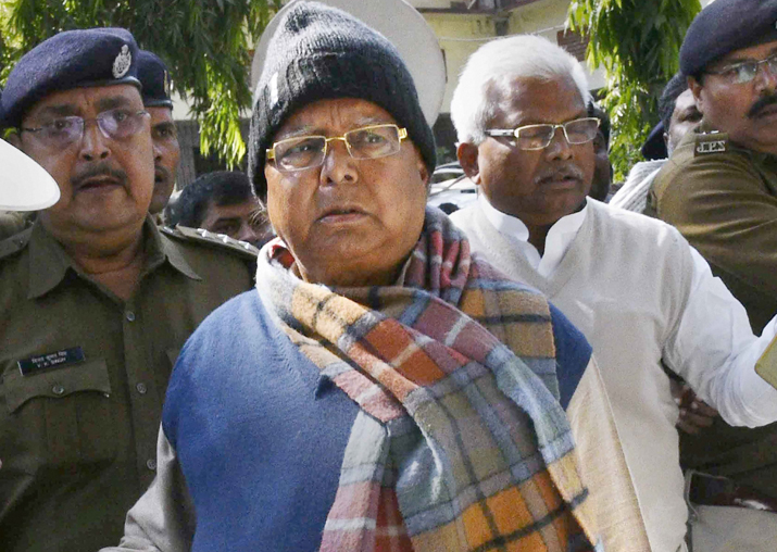 Lalu Yadav escorted by police officials after appearing at
