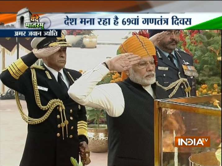 India Tv - PM Narendra Modi and the three Service Chiefs pay tribute at Amar Jawan Jyoti.