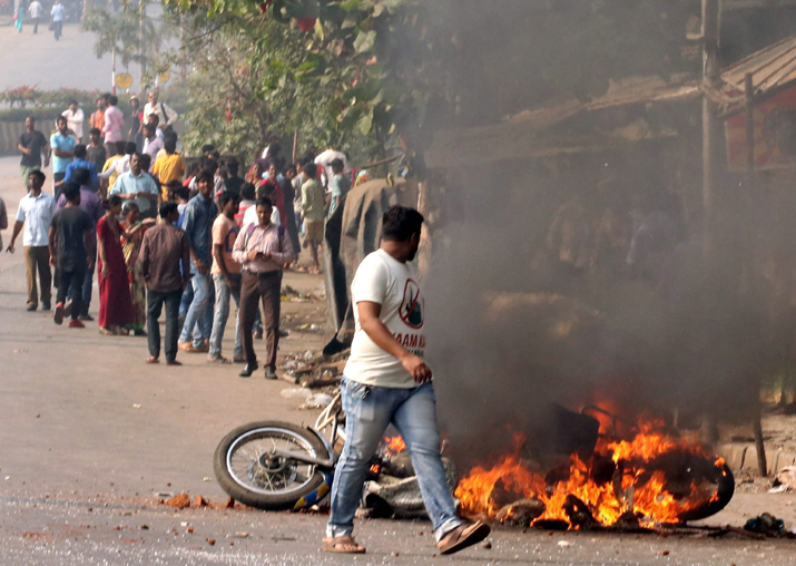 India Tv - Dalit protesters burn a bike at Vikroli in Mumbai on Wednesday during a protest over Bhima Koregaon violence