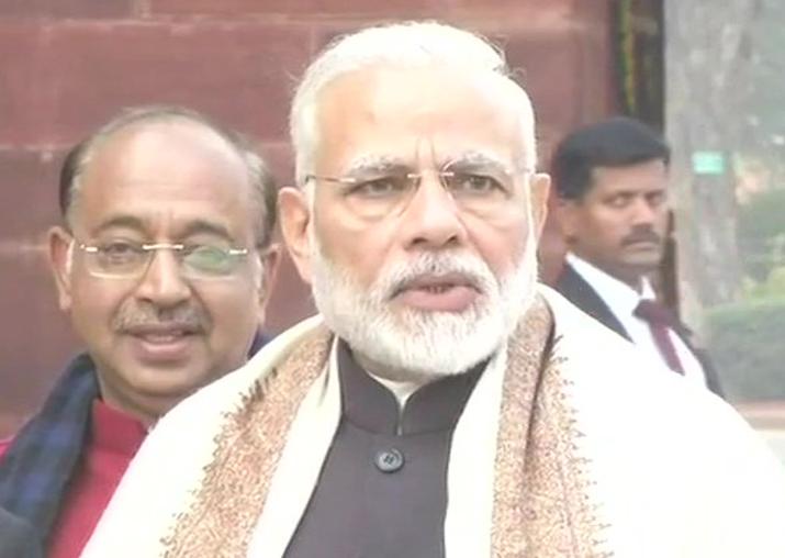 PM Narendra Modi speaks to reporters outside Parliament
