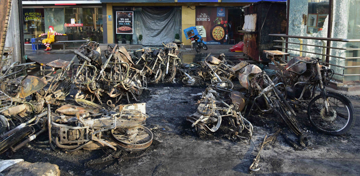India Tv - Charred vehicles outside shops after last night's violence after last night's protest against the release Padmaavat in Ahmedabad on Wednesday