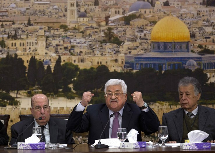 Palestinian President Mahmoud Abbas, center, speaks during