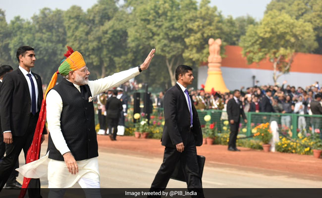 India Tv - PM Modi waves at the crowd after Republic Day parade