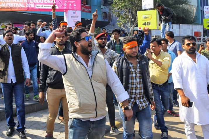 Rajput community people protest outside a cinema hall
